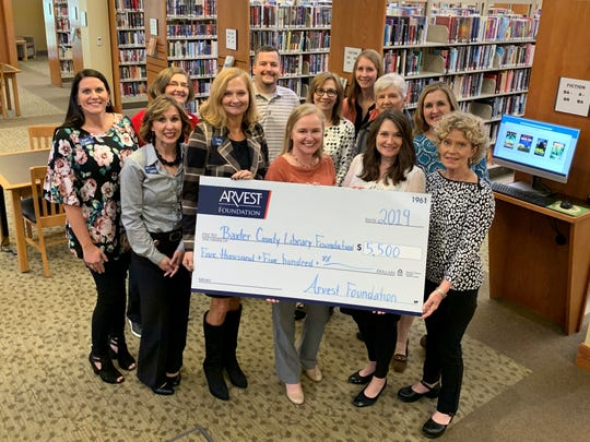 At Arvest Bank's donation presentation at the Baxter County Library were (back row, left to right) Carol Landrum, Zack Lashley, Deborah Chatman, Katrina Neis, Jo Wilson, and Lynn McAlister., (front row, left to right) April Fowler, Adrienne Blackwell, Sally Gilbert, Adeana Estoll, Kim Crow-Sheaner, and Elizabeth VanderStek.