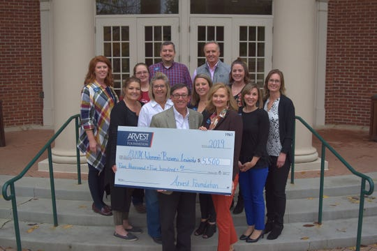 At Arvest Bank's donation presentation at Arkansas State University-Mountain were (front row, left to right) Robin Myers, Sally Gilbert (second row. left to right) Karen Fernandez, Karen Heslep, Tera Payne, Adrienne Blackwell, Dawn Cotter, (third row, left to right) Jaren Beavers, April Woods, Cindy Sutterfield (top row, left to right) Zack Lashley and Mike Willard.