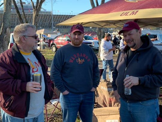 John Patrick (left) holds court with fellow tailgaters Doug Nielsen (center) and Dave Taylor (right) in the Pecan Grove before Saturday's kickoff between ULM and Coastal Carolina.