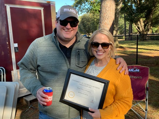 Tyler Harris and his wife, Maegan, celebrate a first-place finish in the ULM Alumni Association's Don Weems Chili Cook-Off on Saturday.