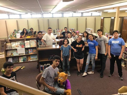 Dover Educational Center's ESCUCHA! Youth Mentorship Program, raised funds to fix the children's library in the Dover library.