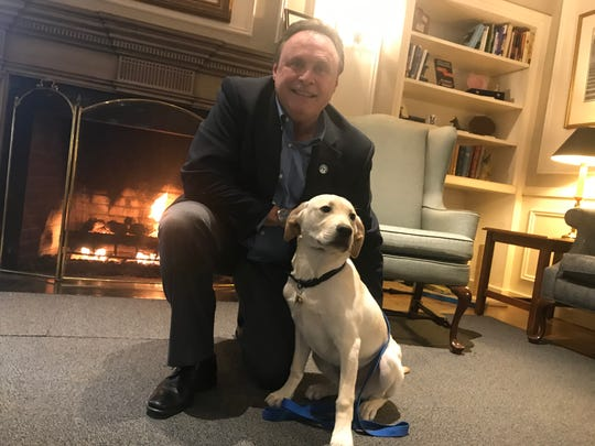 Glenn Hoagland, in the lobby of the Seeing Eye headquarters in Morris Township, N.J. with trainee pup, Fonzi. Hoagland assumed his new position there as CEO Oct. 1, 2019.