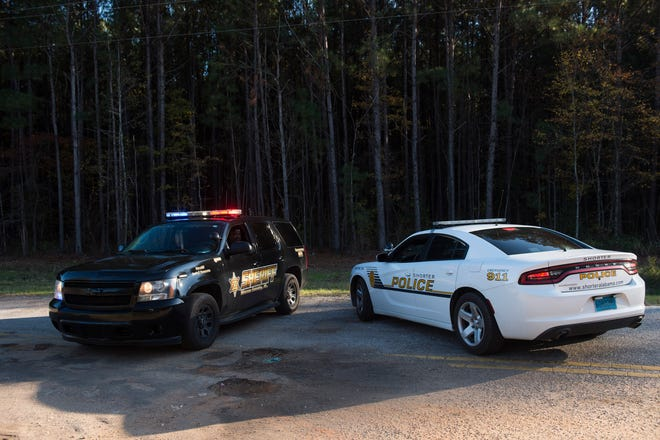 A Sheriff car blocks the County Road 2 where the suspected remains of Aniah Blanchard are being investigated in Shorter, Ala., on Monday, Nov. 25, 2019. Blanchard has not been seen since Oct. 23.