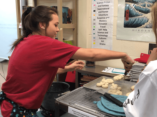 Ninth-graders in Barbara Miller's Yorktown High School English class were paired as pen pals with students in Bonn, Germany. A $427 Robert P. Bell Education awarded during the 2018-19 school year supported the cost of postage and enhanced cultural learning with lessons like German pretzel-making, pictured.