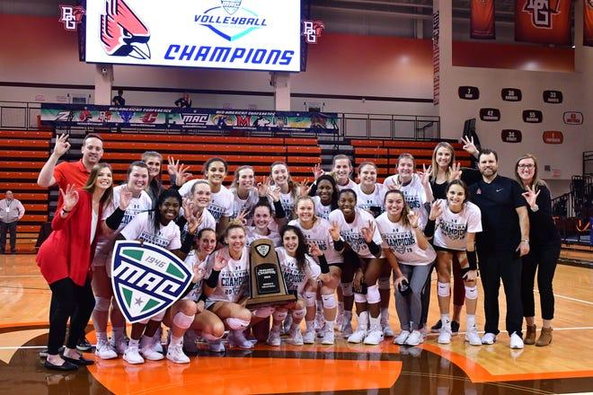 Ball State women's volleyball celebrates winning the MAC tournament title.