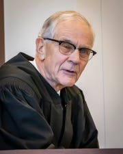 Senior Judge Walter Kurtz listens from the bench during a hearing for Kelsey Ketron on Monday, Nov. 25, 2019, as all other local judges recused themselves from the case.