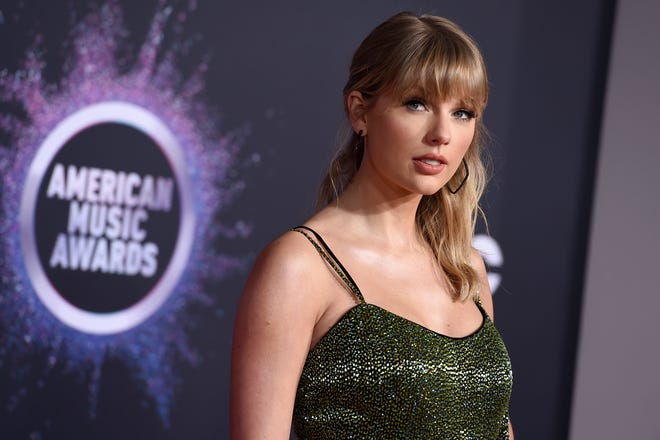 Taylor Swift arrives at the American Music Awards on Sunday, Nov. 24, 2019, at the Microsoft Theater in Los Angeles. (Photo by Jordan Strauss/Invision/AP)