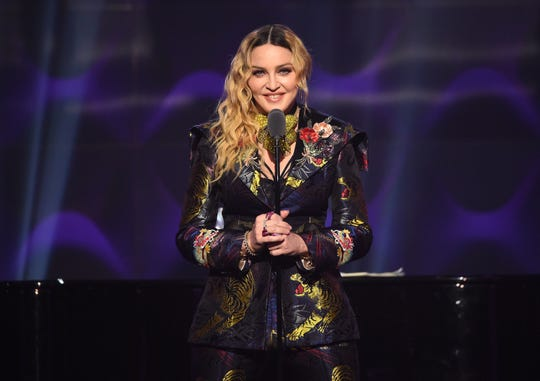 Madonna speaks onstage at the 2016 Billboard Women in Music awards.