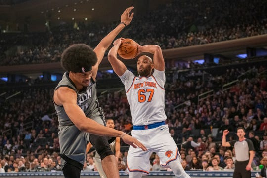 New York Knicks forward Taj Gibson (67) throws Brooklyn Nets center Jarrett Allen (31) off balance in the first half of an NBA basketball game, Sunday, Nov. 24, 2019, at Madison Square Garden in New York. (AP Photo/Corey Sipkin).