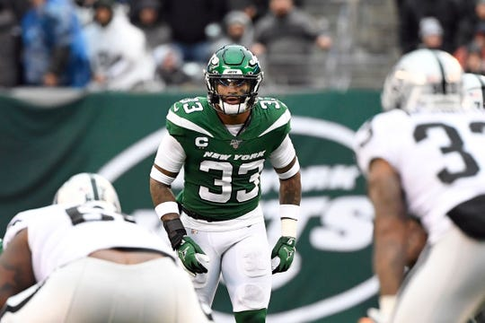 New York Jets strong safety Jamal Adams (33) and the defense take on the Oakland Raiders in the second half. The Jets defeat the Raiders 34-3 at MetLife Stadium on Sunday, Nov. 24, 2019, on East Rutherford.