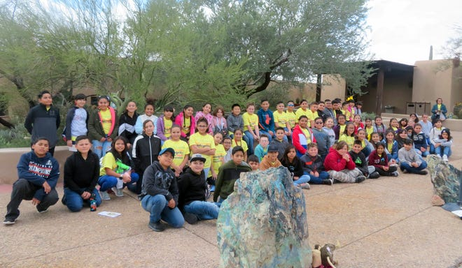 Fifthgraders at Bataan Elementary School enjoyed a rainy day at the Sonoran Desert Museum in Tucson, Arizona. Teachers at Bataan decided to take students to the museum after reading the chapter book, Night of the Spadefoot Toads. The book is about a boy named Ben who lived in Tucson and loves going to the museumuntil he moves with his family to Massachusetts. Before leaving Tucson, the students had a delicious meal at Golden Corral. Students from Melissa Noriega's, Gina Simms's, and Kim Perea's classes raised the money for the trip by selling chocolate bars.
