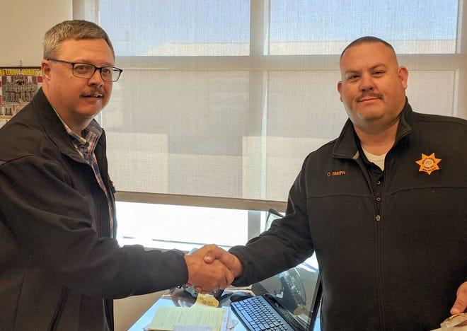Luna County Sheriff Kelly Gannaway (left) congratulates Deputy Patrol Corporal Arthur Smith.