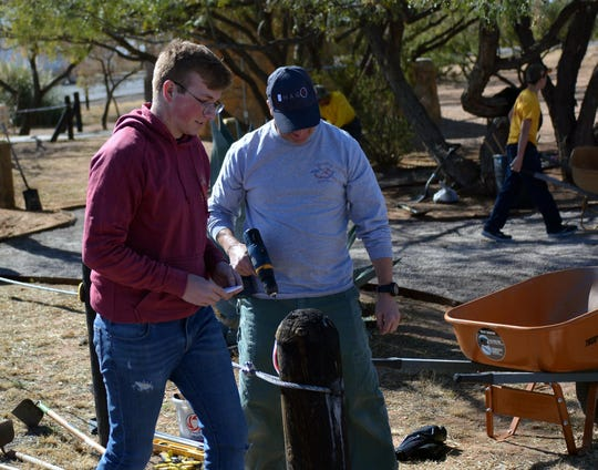 Evan McDonald, left, and his father, Greg McDonald helped build a pet relief area Saturday, Nov. 23, 2019. The pet relief area is at the Scenic Overlook Rest Area on Interstate 10 west of Las Cruces.