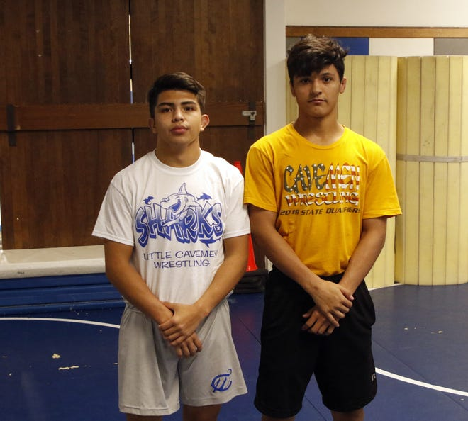 Carlsbad sophomore wrestlers Matthew Najera, right, and Anthony Fuentes, left, pose on Nov. 22, 2019. Both wrestlers made it to the state tournament last year and work hard to maintain their wrestling weights, even during the holiday season.
