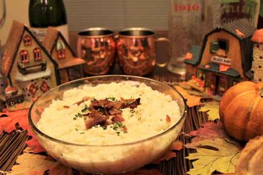 Cauliflower mash, when mixed with Boursin cheese, butter and garlic, makes a lower carb Thanksgiving side dish that can be served during the holiday.