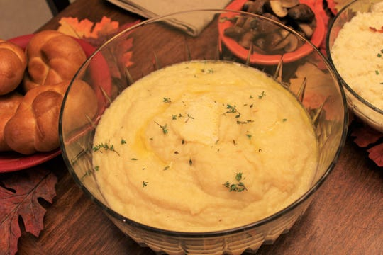 A small amount of potato pureed with celeriac, onion, garlic and fresh thyme make a lower carb Thanksgiving side dish.