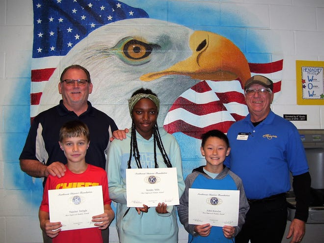 Alamogorod Kiwanis Club is honoring the Most Improved Students at Holloman Middle School. Pictured are:  Back Row:  Principal Joe Keith, and Kiwanis Ned Kline Front Row: seventh grader Thatcher Swingle, eitghth grader Kendra Mills and  sixth grader Aiden Knowles