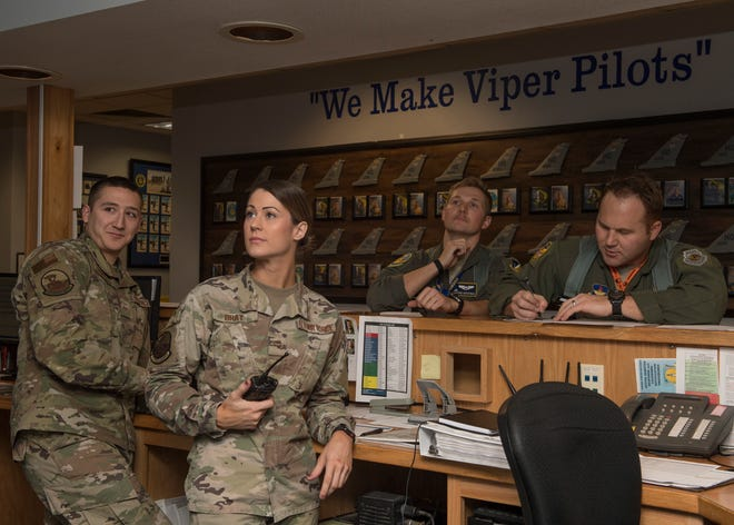 Squadron aviation resource managers with the 311th Fighter, view the weather forecast with pilots during a step brief, Nov. 20, 2019, on Holloman Air Force Base, N.M. After the pilots step, they radio in any problems they may have to the SARM working the operations desk and the SARM relays it to maintenance.