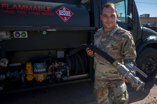 Tech. Sgt. Thomas Harris, 49th Logistics Readiness Squadron non-commissioned officer in charge of fuels distribution, holds a modified nozzle made for ground fuels, Nov. 14, 2019, on Holloman Air Force Base, N.M. The fuels distribution element recently purchased two R-13 Mobile Refueling Unit vehicles to ensure ground equipment and vehicles are getting the fuel they need.