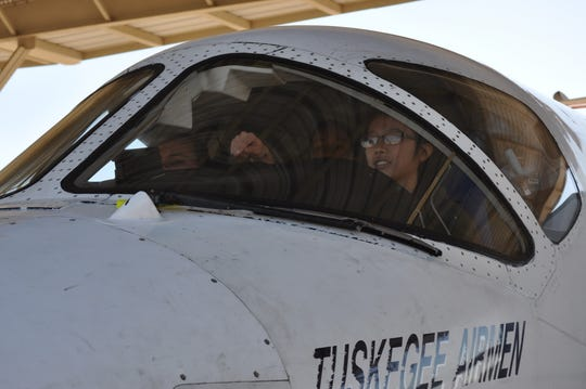Members from 19th Air Force, surgeon general's office and 99th Flying Training Squadron instructor pilot conduct a cockpit assessment on pilot candidate Mary Tighe from a Reserve Officers' Training Corps detachment in Kansas who does not meet minimum height standards to be an Air Force pilot.  Once a candidate is selected for a pilot slot, they will have their Initial Flying Class I physical exam, which automatically places a candidate into the waiver process, if they do not meet height standards.