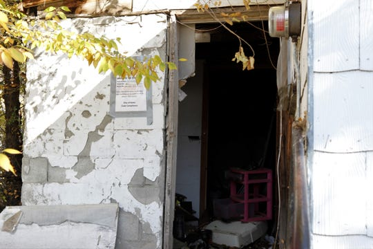 Clutter is seen inside a back entrance to a house on McCoy Avenue.