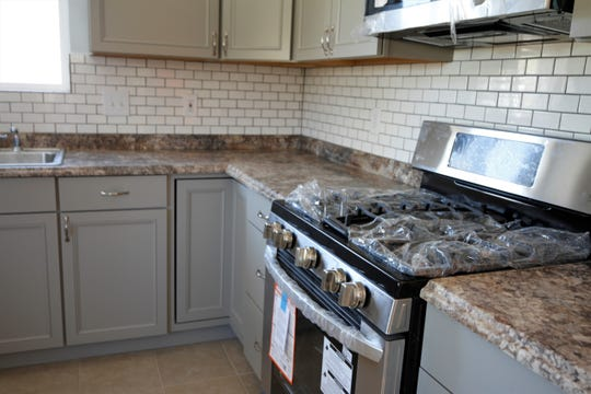 The renovated kitchen at 705 Apache Avenue in Aztec is pictured on Oct. 24 after the Atchison family fixed up the formerly trashed house.