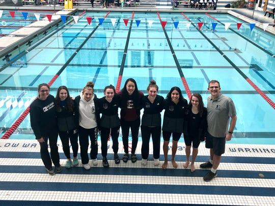 South Lyon East's 2019 swim team was represented at states by assistant coach Kacie VanBuskirk, Melanie Cosens, Sophia Ohland, Kayla Kosior, Hannah Sun, Lindsay Boals, Maria Mayorga, Abby Seybert and head coach John Burch.