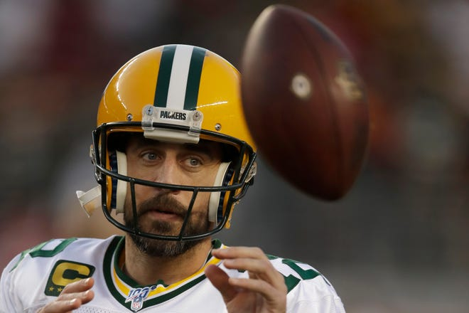 Green Bay Packers quarterback Aaron Rodgers warms up before an NFL football game against the San Francisco 49ers in Santa Clara, Calif., Sunday, Nov. 24, 2019. (AP Photo/Ben Margot)