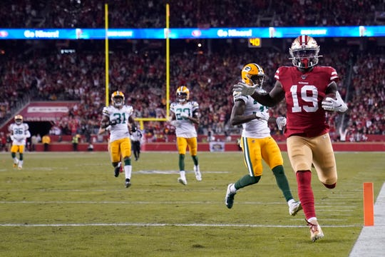 San Francisco 49ers wide receiver Deebo Samuel (19) scores against the Green Bay Packers during the first half of an NFL football game in Santa Clara, Calif., Sunday, Nov. 24, 2019. (AP Photo/Tony Avelar)