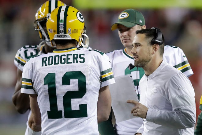 Green Bay Packers quarterback Aaron Rodgers (12) talks with head coach Matt LaFleur, right, during the second half of an NFL football game against the San Francisco 49ers in Santa Clara, Calif., Sunday, Nov. 24, 2019. (AP Photo/Ben Margot)