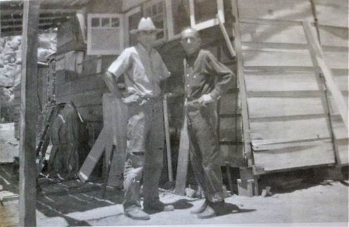 Worth Bagley (left), and Eugene Savard (right), in front of Bagley's desert home early 1940s. It is one of about a dozen homes built by private landowners inside Joshua Tree National Monument.