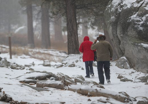 People hike the Desert View trail at Mt. San Jacinto State Park after the season's first snowfall, November 20, 2019.