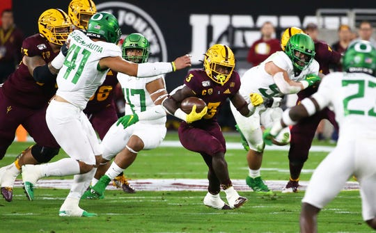 Arizona State Sun Devils running back Eno Benjamin (3) runs against the Oregon Ducks in the first half during a game on Nov. 23, 2019 in Tempe, Ariz.