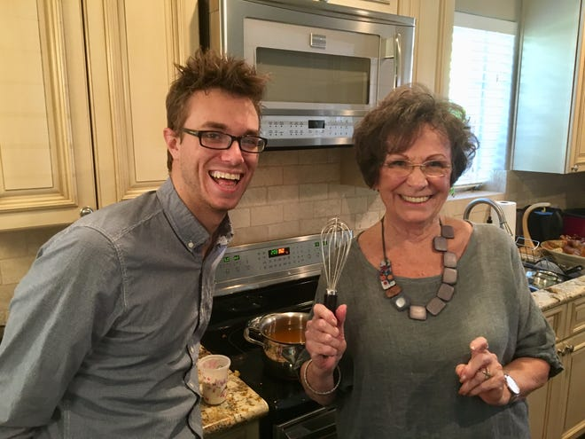 Sawyer Bland learning how to make gravy from his Nana, Marilyn Bland, whose gravy is the best.