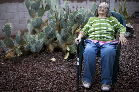 Bridget O'Brien sits in her backyard in Peoria on Nov. 21, 2019. O'Brien is a client of the volunteer-run service Benevilla, which has a volunteer pick up O'Brien's grocery list biweekly and deliver groceries to her home.