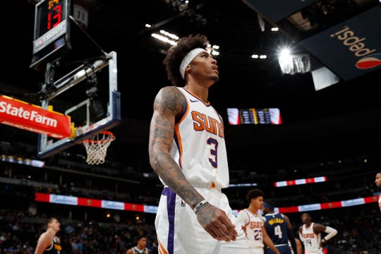 Phoenix Suns forward Kelly Oubre Jr. heads to the bench as time runs out in the second half of an NBA basketball game against the Denver Nuggets, Sunday, Nov. 24, 2019, in Denver. The Nuggets won 116-104. (AP Photo/David Zalubowski)