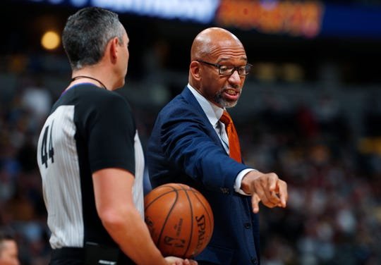 Phoenix Suns head coach Monty Williams, right, argues for a call with referee Eli Roe in the first half of an NBA basketball game against the Denver Nuggets, Sunday, Nov. 24, 2019, in Denver. (AP Photo/David Zalubowski)