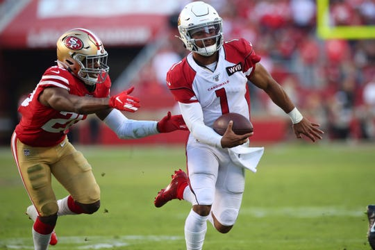 Cardinals quarterback Kyler Murray (1) runs for a touchdown during a game against the 49ers on Nov. 17 at Levi's Stadium.