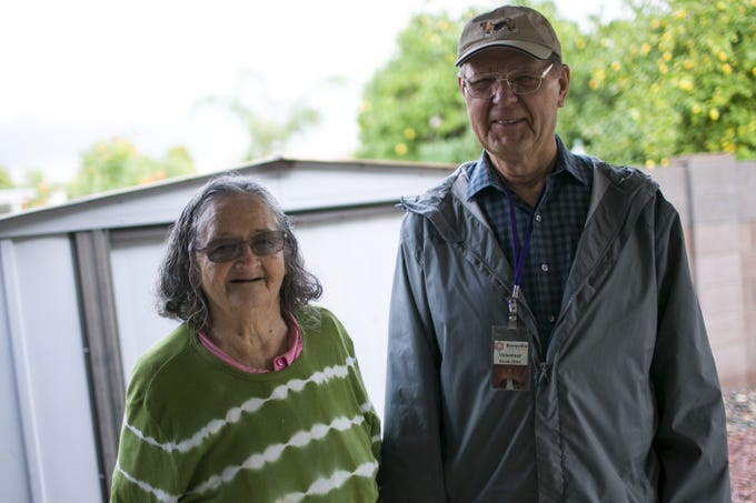 Bridget O'Brien (left) stands with Benevilla senior services volunteer Ernie Otto (right) at her home in Peoria on Nov. 21, 2019. Otto picks up and delivers groceries for O'Brien on a biweekly basis.