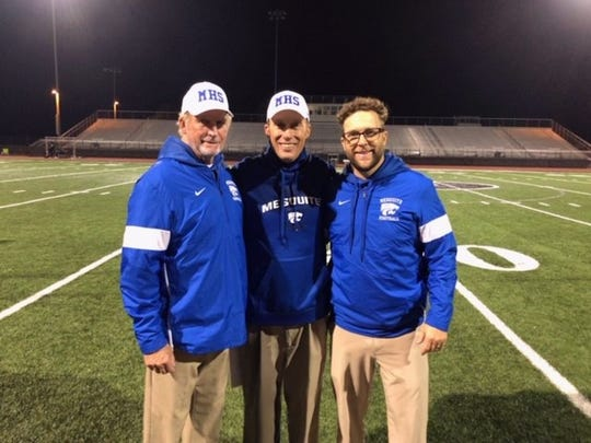 Mesquite coach Scott Hare, center, is joined by his father Steve, left, and brother, Cory.