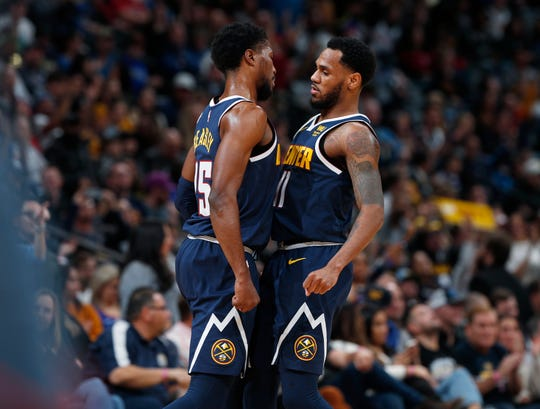 Denver Nuggets guard Malik Beasley, left, bumps chests with guard Monte Morris after Beasley hit a three-point basket against the Phoenix Suns in the second half of an NBA basketball game Sunday, Nov. 24, 2019, in Denver. The Nuggets won 116-104. (AP Photo/David Zalubowski)