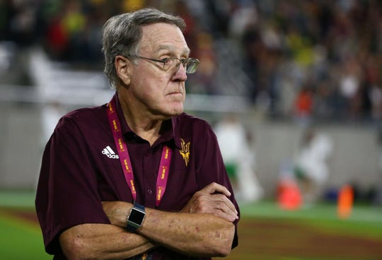 Al Luginbill, ASU football director of player personnel, watches the action during the second half of a game against Oregon on Nov. 23 at Sun Devil Stadium.