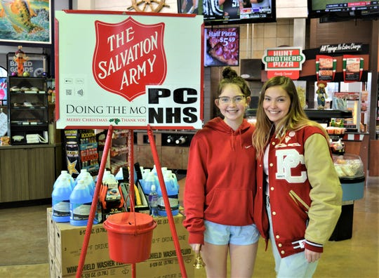 Port Clinton High School Juniors and National Honor Society Members Emma Gottron, left, and Kierstin Sherer volunteered for a two-hour Red Kettle shift at the Marathon Friendship Food Store in Port Clinton on Nov. 23. The NHS group adopted the site for the day and took turns manning shifts.