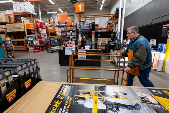 Wayne Pyden pushes a shopping cart through the Fort Gratiot Home Depot during his shift Monday, Nov. 25, 2019. Pyden served on the Marysville City Council from 2013 to 2017, and was elected this year to be Marysville's mayor.
