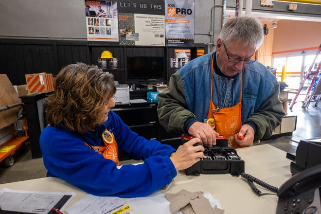 Wayne Pyden, right, works with pro sales associate Cathy Petiprin to open a pack of ratchet straps for a customer Monday, Nov. 25, 2019, at Home Depot in Fort Gratiot. Pyden served on the Marysville City Council from 2013 to 2017, and was elected this year to be Marysville's mayor.