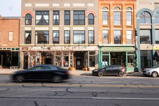 A car drives past several downtown businesses Monday, Nov. 25, 2019.