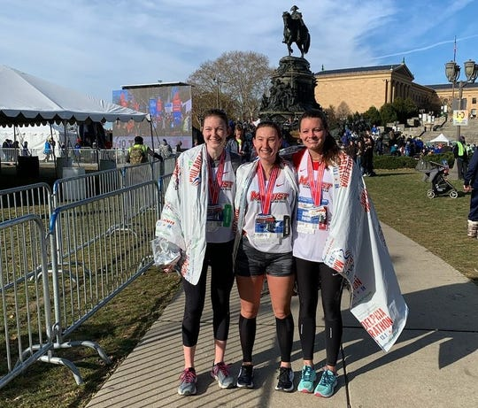 Marist alums Brianne Vess, left to right, Catherine Ferreri and Annie Gould are shown at the Philly Half Marathon.
