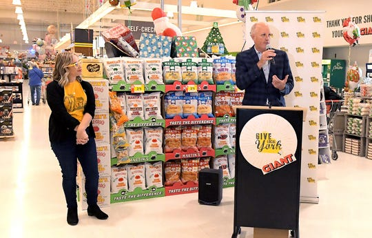 Meagan Given, executive director of the White Rose Leadership Institute, listens as York Revolution President Eric Menzer speaks during a press conference announcing the return of Give Local York at the Delco Plaza Giant, Monday, Nov. 25 2019. Giant is a presenting sponsor for the fundraiser which will be held May 1, 2020. Bill Kalina photo