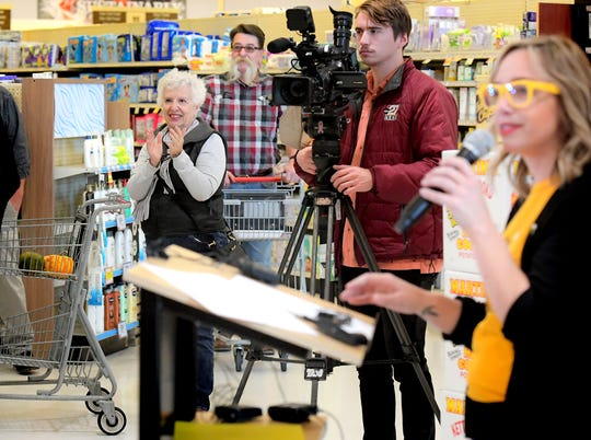 Dottie Rohrbaugh, left, of Manchester Township pauses while shopping at the Delco Plaza Giant, Monday, Nov. 25, 2019, to listen to a press conference announcing the return of Give Local York. Giant is a presenting sponsor in the fundraiser which will be held May 1, 2020. Rohrbaugh is a former employee of the United Way, which supports event. Bill Kalina photo