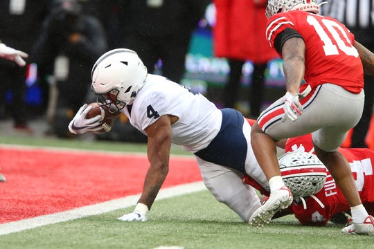 Nov 23, 2019; Columbus, OH, USA; Penn State Nittany Lions running back Journey Brown (4) scores a touchdown during the third quarter against the Ohio State Buckeyes at Ohio Stadium. Mandatory Credit: Joe Maiorana-USA TODAY Sports
